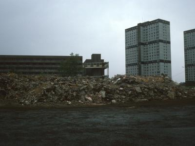 View of 7-storey block undergoing demolition