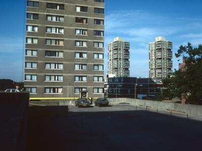 View of 21-storey blocks on Battersea Church Road with Surrey Lane Estate block in foreground