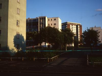 View of 6-storey blocks from Great Lister Street with Elm Tree Tower in background