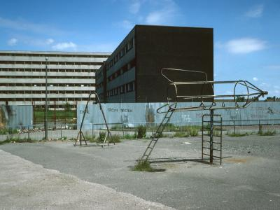 View of 8-storey block in Netherley with park and low-rise block in foreground