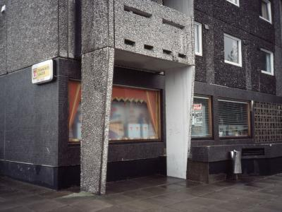 View of shop on lower floor of a block on Callendar Estate Section 4