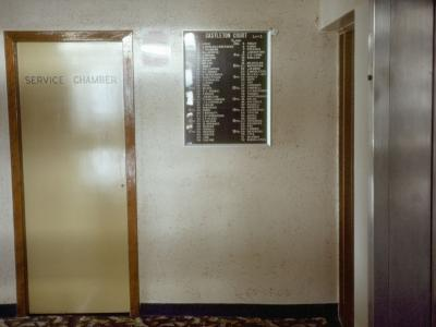 View of hallway and elevator in Castleton Court