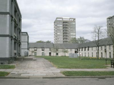 View of one 12-storey block on Hazlehead developmen, behind low rise housing