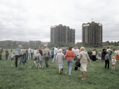 Crowds gather to watch the demolition of the Nursery Farm Estate